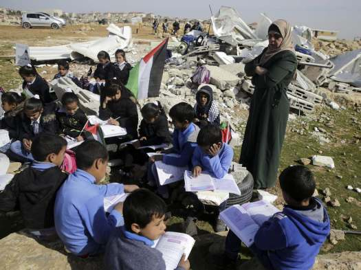 Bedouin-children-attend-improvised-class-in-the-village-of-Abu-Nuwar-West-Bank-after-the-Israeli-army-demolished-their-two-classroom-school-in-the-West-Bank-in-February-2016-AP-